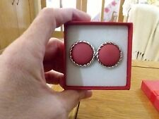 Brand new light weight silver look earrings with large pink centres and gift box
