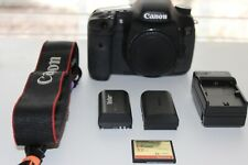 EOS 7d body only  SLR camera with 2 batteries, charger, and compact flash card.