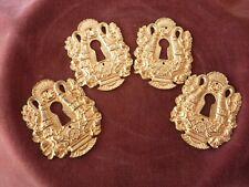 4 entrées de serrure Charles X en bronze doré,numérotées,pour commode