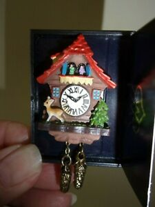 CUCKOO CLOCK RED ROOF  -  - REUTTER PORCELAIN -