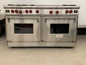 """2012 Wolf 60"""" Pro Gas range: 6 burners /1 inferred griddle / 1 inferred grill"""