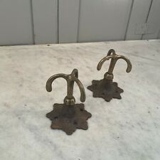 Pair antique Victorian cast iron brass rotating ceiling mounted clothes hooks