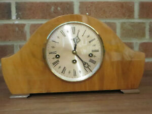 A BENTIMA 8 DAY THREE TRAIN MANTLE CLOCK WITH A HERMLE FLOATING BALANCE