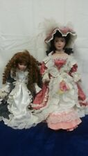 "2 Victorian Inspired Porcelain Dolls 21 1/2"" x 10 3/4"", 16 3/8"" x 9 1/2"" Good co"