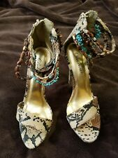 Women's New Delicious Snake print heels Size 6 with ankle beads