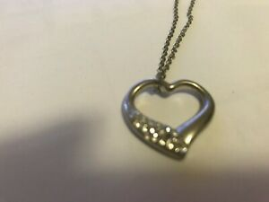Silver Plated Heart Pendant with faux diamonds engraved has a chain