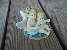 Vintage Angel Holding Baby Butterfly Floral Figurine Iridescent Wings