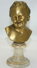 BUST OF CHILD. ORMOLU. ON MARBLE. SIGNED HOUDON. FRANCE. XIX
