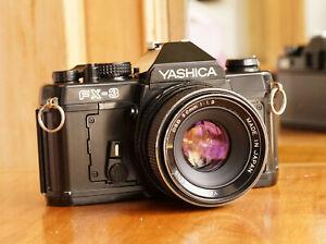 Black Yashica FX-3 35mm Film SLR w/ 50mm f/1.9 Lens