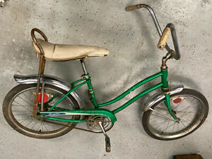 Sears green muscle bike with banana seat and sissy bar