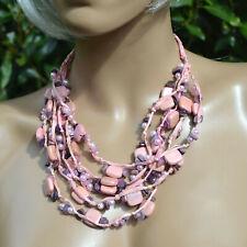 1760a0d08e2b8 collier ethnique en bois rafia perle rose pastel multi rang ZAZA2CATS