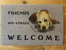 Golden Labrador in the hey 'Friends Are Always Welcome' Dog door mat
