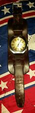Guess Brown Leather Cuff Watch G75620G with round gold face