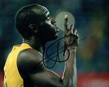 Usain Bolt RARE SIGNED Olympic Athlete 10x8 Photo AFTAL Autograph COA