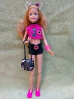 BARBIE DOLL SISTER STACIE WEARING KITTY CAT CLOTHES DOLL HOLDING A PURSE