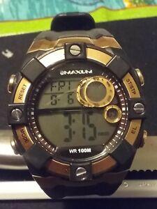 Maxum digital wrist watch gold and black