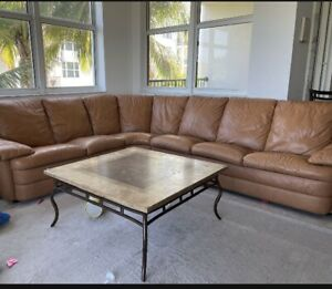 Natuzzi Italian Leather sectional, color Brown, three pieces in total.