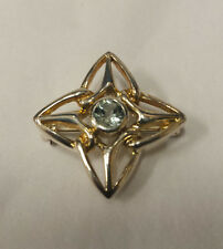 Silver Celtic Star Shaped Brooch With A Blue Topaz Centre Stone