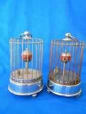 Two (2) Birdcage Clocks