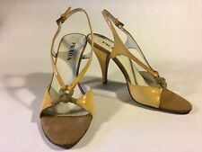 Prada, yellow leather heels with gentle patina, rope details, and hessian toe 10