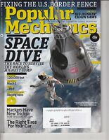 Popular Mechanics Magazine , Space Live Cover, August 2010 , chain saws , tires