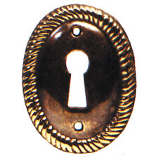 Keyhole cover / vertical escutcheon in antique brass. 28mm x 38mm