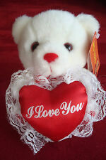 """Nwt stuffed bear holding red heart Plays Music, with """"I Love You� on it"""