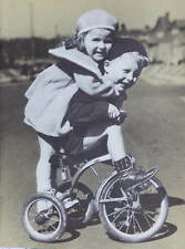 Vintage 1950s print Boy and Girl on old fashioned trike