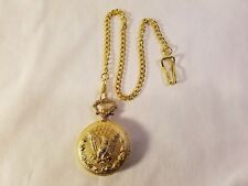 Gold Colored Pocket Watch With An Eagle