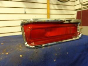 1969 Plymouth Fury I II LH Tail Light Bezel  and lens 2930401