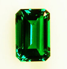 Emerald White Gold Three-Stone Engagement Rings