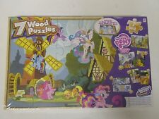 7 Wooden Jigsaw Puzzles in a Storage Tray, New Sealed and Unopened.
