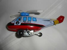 MTU Police Helicopter Wind Up Tin Toy  Korea  (works)