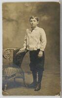 RPPC Young Man wearing knickers Studio  Portrait Real Photo c1911 Postcard K13