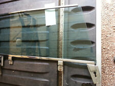 63-64 Cadillac coupe L. Door glass and frame