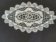 Vintage oval white crocheted cloth with butterflies.