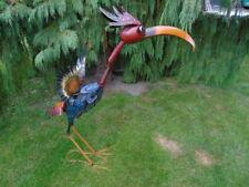 oiseau en fer forgé avec tête sur ressort ,bouge tous seul avec le vent ...