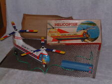 VINTAGE BATTERY OPERATED, TIN HAJI HELICOPTER W/TETHERED REMOTE CONTROL & BOX!!