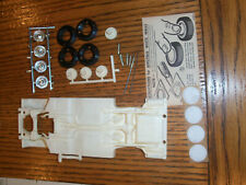 1963 AMT LINCOLN CV 1/25 model car annual  6413- ROLLING CHASSIS W/ STOCK COVERS