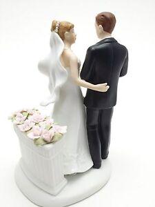 Bride and Groom black tie and pink roses