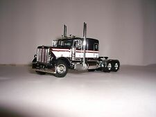 DCP 1/64 BLACK&WHITE WITH RED STRIPE 379 PETERBILT WITH 63'' FLAT TOP SLEEPER