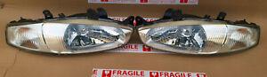 Mitsubishi ASTI Mirage CYBORG CJ1A CJ4A COLT Crystal HEAD LIGHTS Pair oem used