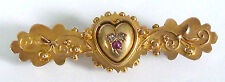 A VICTORIAN 15CT GOLD BROOCH WITH A CENTRAL HEART SET WITH A RUBY & DIAMONDS