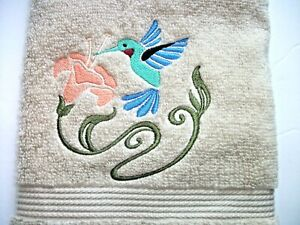 HUMMINGBIRD EMBROIDERED DESIGN ON A BEIGE HAND TOWEL
