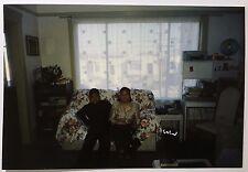 vintage PHOTO awkward photo taken while sitting on couch