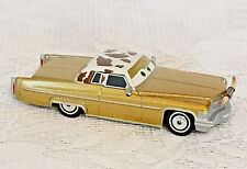 DISNEY PIXAR CARS TEX DINOCO GOLD WITH HORNS ON FRONT