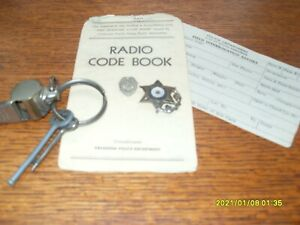 Lot Vintage Police Whistle Hand cuff keys Police radio code book police badge