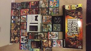 PlayStation 2 Slim, Wireless Guitar Hero 3 Guitar, and 32 Games