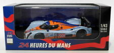 Voitures de courses miniatures orange pour Aston Martin