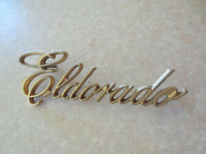 Original 1980s Cadillac Eldorado car metal badge - gold color